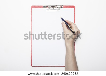 A female(woman) hand hold a pen and red clipboard with paper(document, report) isolated white, top view at the studio. - stock photo