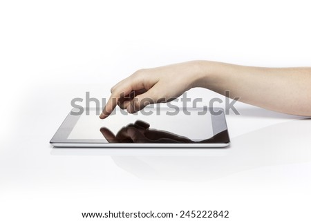 A female(woman) hand touch(push) the blank(empty) tablet pc(pad) isolated white at the studio. - stock photo