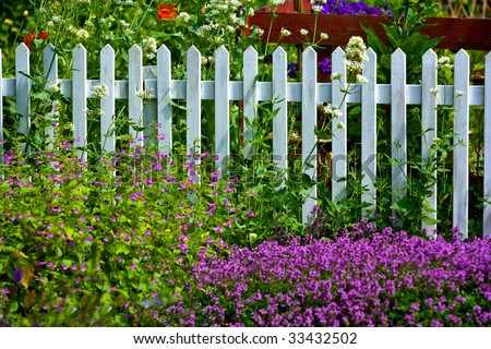 A  fence in a beautiful garden - stock photo