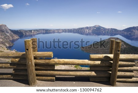 A fence keeps you safe at crater lake national park Oregon USA - stock photo
