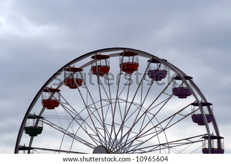 A ferris wheel against a cloudy sky