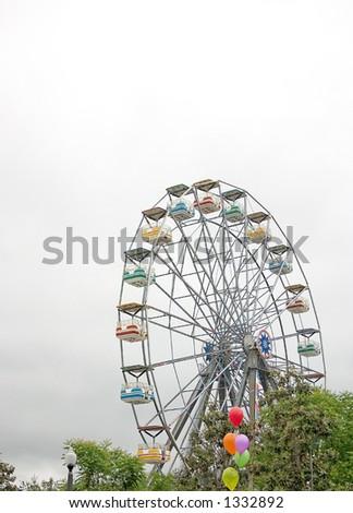 A ferris wheel in an amusement - stock photo