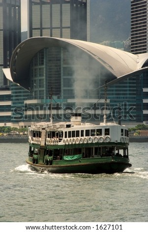A ferry passing by Hong Kong Convention And Exhibition Centre - stock photo