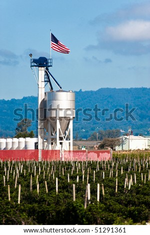 A fertilizer blending tower with an American flag - stock photo