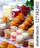 a festive bouffet for a party with pastries and drinks - stock photo