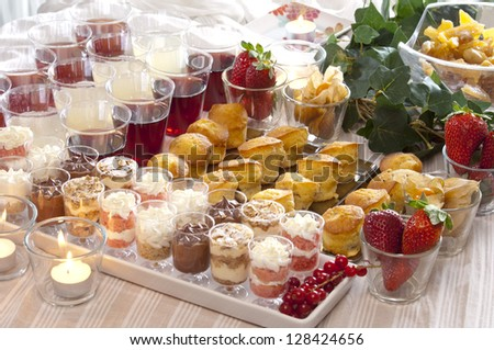 a festive buffet for a party with pastries and drinks - stock photo