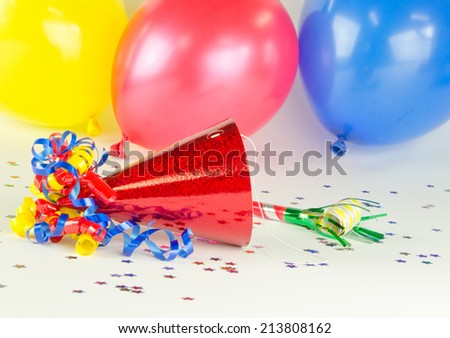A festive image with balloons and a party hat