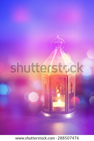 A festive Ramadan background. Abstract light effects with arabic lantern. Stock photograph. - stock photo
