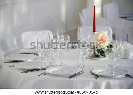 A festive table  for a celebration. Banquet table with Cutlery and tableware. Table with white tablecloth served to guests. The table in the restaurant. Luxury Desk for the celebration. - stock photo