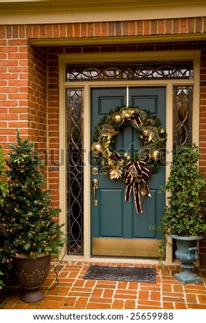 A festively decorated front door at Christmas - stock photo