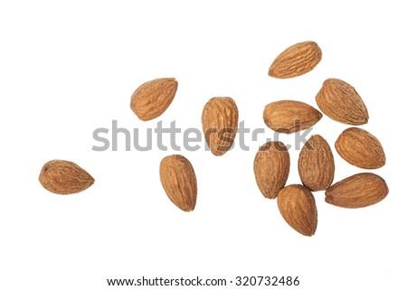 A few almonds on white background - stock photo