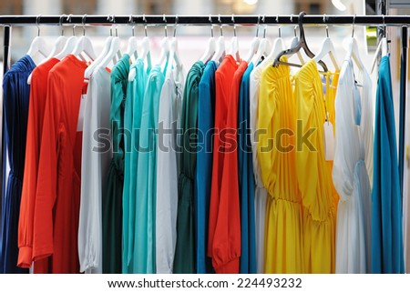 A few beautiful wedding or evening dresses on a hanger