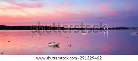 A Few Boats At Rest Just After Sunset On This Calm, Quiet Evening In Gloucester Bay, Gloucester, Massachusetts, USA - stock photo