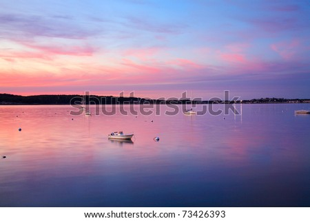 A Few Boats At Rest Just After Sunset On This Calm, Quiet Evening In Gloucester Bay; Gloucester, Massachusetts, USA - stock photo