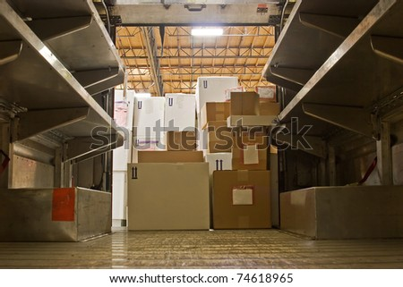 A few boxes remain to be moved out of the delivery truck. - stock photo