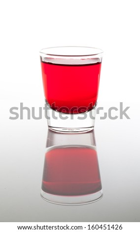 a few glasses of drinks in red - stock photo