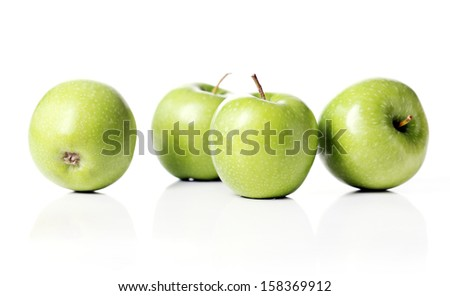 A few green apples over a white background - stock photo