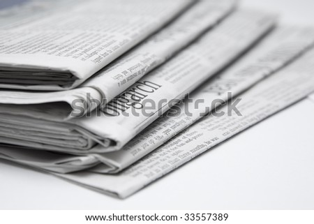 A few newspapers slanted to the side - stock photo
