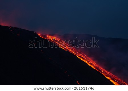 A few steps from the lava front. The casting continues to fall inside the valle del bove. - stock photo