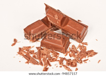 A few sweet hocolate blocks lying on a white surface