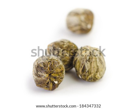 a few tea unopened flower buds of green Chinese tea, isolated on white background - stock photo
