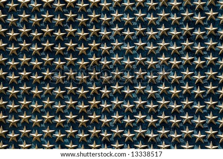 A field of gold stars on the WWII memorial.  Each star represents 100 American deaths. - stock photo
