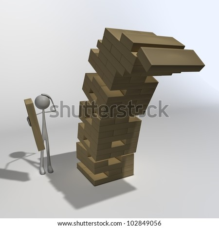 a figure is playing Jenga and made the last move - stock photo
