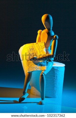 a figure with toilet paper. photo icon for bowel disease - stock photo