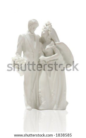 A figurine of a wedding couple, perfect for a background