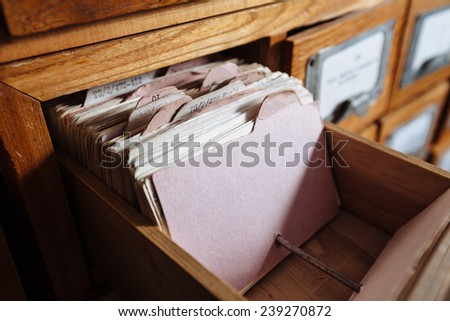 A file cabinet drawer full of files. shelf filled with files - stock photo