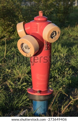 A fire hydrant in the evening sun - stock photo