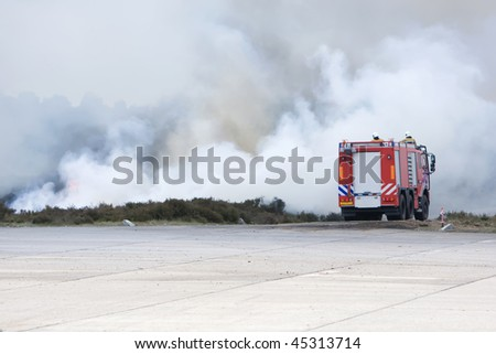 A fire truck is fighting the fire. - stock photo
