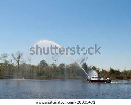 A fireboat putting out a shoreline fire.