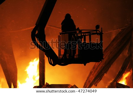 A firefighter in action - stock photo