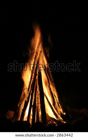 A fireplace with burning fire