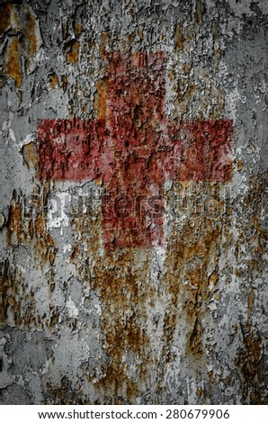 A First Aid Red Cross On A Grungy Rusty Texture Background - stock photo