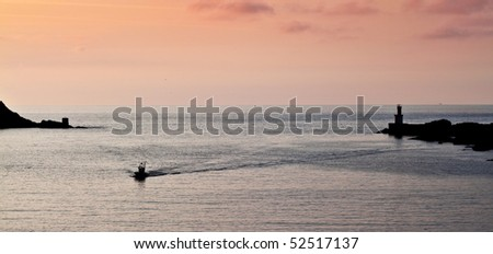 A fisher boat returning to the port. - stock photo