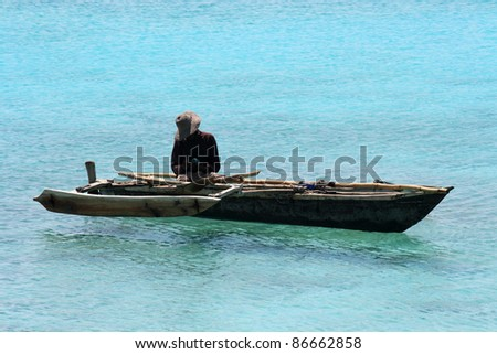 A fisherman on a quiet sunny day - stock photo