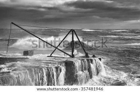 A fisherman's crane at Portland Bill in Dorset being swamped by a winter storm.
