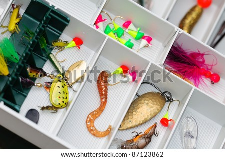 A fisherman tackle box with lures and gear for fishing. - stock photo