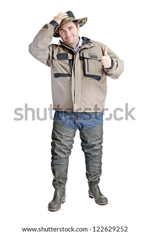 a fisherman with boots and a jacket isolated on a water background