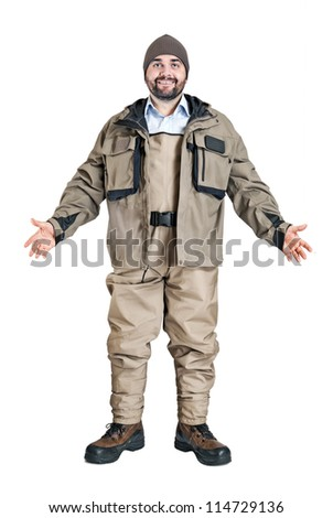 a fisherman with waders and a jacket isolated on a water background - stock photo