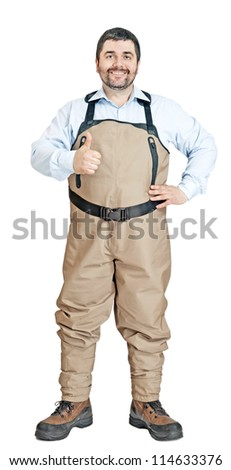 a fisherman with waders isolated on a water background - stock photo