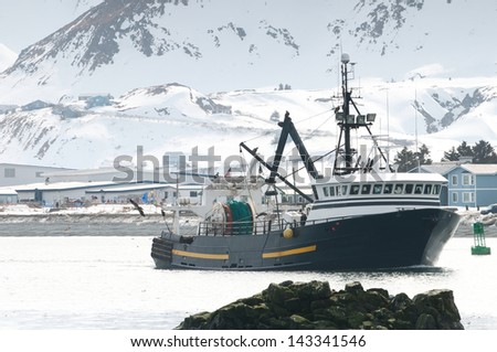 A fishing boat on the bay in Dutch Harbor - stock photo