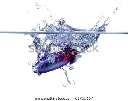 A fishing lure splashing down into water - stock photo