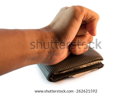 A fist placed on the wallet - stock photo