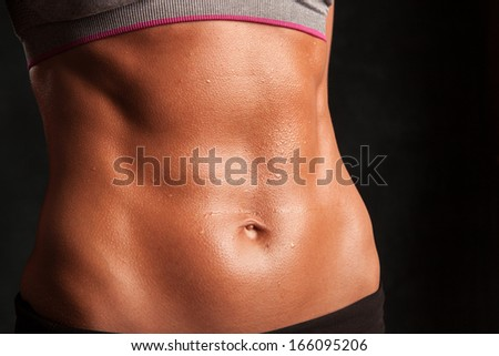 A fit stomach - stock photo
