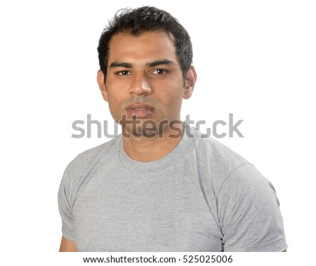 A fit young Indian Asian man in a light t-shirt looking to camera - studio shot isolated on white