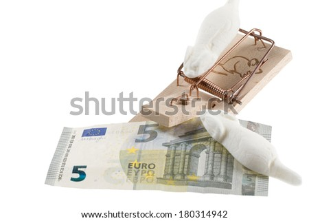 A five Euro banknote is catched by a mousetrap. - stock photo