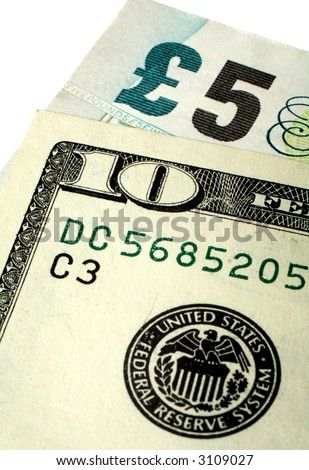 A five pound note and a ten dollar bill - the dollar moved above the 2:1 level on April 18, 2007. - stock photo